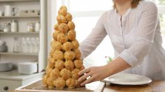 Croquembouche, or 'crunch in the mouth', is a deliciously decadent, towering stack of vanilla cream-filled profiteroles bound together in a pyramid by a cobw...