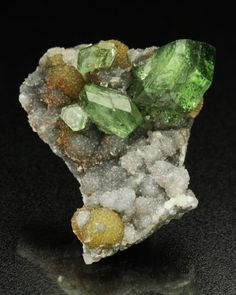 """Ludlamite with Siderite-$450-SOLD  Blackbird Mine, Blackbird District, Lemhi Co., Idaho  Overall Size: 2.2 x 2.1 cm  """"An especially attractive specimen of lush green ludlamites over glassy quartz and botryoidal siderite. Mostly found in tightly packed crystals, it is nice to see such a handsome group."""""""