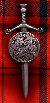 """Sword and Targe, Celtic Horses Kilt Pin by Brooches, Penannulars and Kilt Pins. $26.00. Great for Renaissance, highlander games, medieval. Great for Musketeer, Tudor, Medieval, Renaissance, Colonial, or Regency Clothing. Solid Pewter Sword and Targe, Celtic Horses Kilt Pin With a strong Military Pin & Clasp. 4"""" long (Sword) X 1 1/4"""" inches wide (shield). Sword and Targe, Celtic Horses Kilt Pin With a strong Military Pin & Clasp. 4"""" long (Sword) X 1 1/4"""" inches..."""