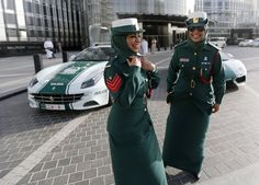 "Policewomen. Dubai. One of the biggest challenges facing these women is arresting men. Arab and Muslim culture view it as extremely shaming for a man to be made a woman's prisoner. ""We have to handle it sensitively,"" says Officer Fatima Ahmed (left), "" but if we catch a man breaking the law, we will arrest him, whether he is Muslim or not."" Have you ever had to handcuff a male Muslim suspect? I ask. ""Of course!"" Fatima replied. How do they react? ""With fury!"" grinned her colleague Nasrin…"