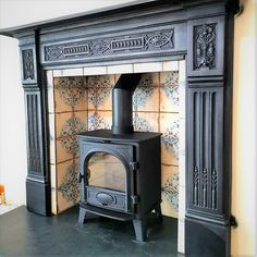 Cast iron period fireplace surround and wood burner adding a period look to a modern stove Wood Stove Surround, Wood Fireplace Surrounds, Wood Burner Fireplace, Cast Iron Fireplace, Black Fireplace Surround, Tiled Fireplace, Fire Surround, Cozy Fireplace, Fireplace Ideas