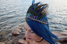 Want to kill the Mardi Gras parade with a sexy stunning peacock costume? I got you covered! Truly astonishing Peacock headdress made of perfectly shaped titanium plated quartz crystals, natural peacock feathers, gold color wire. The crown is very elegant, lightweight, comfortable and sturdy with no excessive wire wrapping. The headdress is held on hair with two small combs attached to the sides of the headband, which allows a crown to sit on your hair tightly, even if you dance, jump, shake…