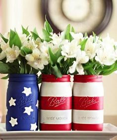 Create a centerpiece by painting the flag pattern on a row of three jars. Place them on a tray or rectangular plate and fill with pretty flowers – simple white ones will work best and won't take away from the flag design.