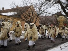 February 19, 2012: Revellers wearing masks participate in the traditional Buso Carnival in Mohacs, 200 km (124 miles) south of Budapest. At the Buso Carnival, which lasts for six days, locals celebrate the end of winter and party before the start of Lent. According to legend, the masks helped locals scare away the Turks in the 16th century.