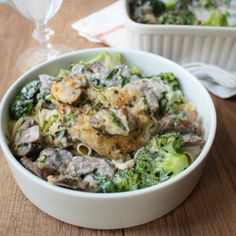 An elegant chicken divan with broccoli, mushrooms, chicken thighs, egg noodles, and a deliciously creamy sour cream and basil sauce.