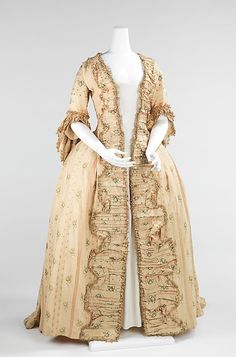 Dress (Robe à la Française). The striped textile here is indicative of the change in aesthetics around 1765 to a more neoclassical taste, less florid than the silks of the decades prior to them.