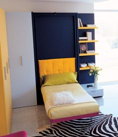 The LGS is a vertically opening, murphy bed system that rotates 180 degrees to reveal a space saving twin wall bed.