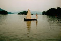 My father Martin Neville in his Humber Yawl on Windermere