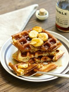Light and crispy sourdough waffles, topped with sweet maple and cinnamon-scented bananas.  http://aredbinder.com/2016/11/sourdough-waffles-with-brown-sugar-maple-bananas.html