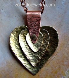 More Metal Work Etched and Wire Jewelry 2019 Three brass hammered hearts riveted onto a copper bail The post More Metal Work Etched and Wire Jewelry 2019 appeared first on Metal Diy. Mixed Metal Jewelry, Metal Clay Jewelry, Steel Jewelry, Enamel Jewelry, Copper Jewelry, Wire Jewelry, Jewelry Art, Jewelry Design, Bullet Jewelry