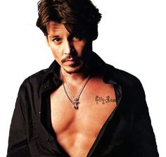 In a photo shoot for Rolling Stone magazine, Johnny Depp bares his chest to show his tattoo of his daughter's name, Lily-Rose, over his heart.