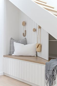 Stairs in entryway design with storage. Love the white headboard & pale wood tone & hook placement. So fun & unexpected! Decor, House, Interior, Beach House Storage, House Inspiration, Home Decor, House Interior, Interior Design, Trendy Home