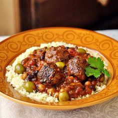 Moroccan Meatball Stew - here's a terrific slow cooked supper that will fill the entire house with the most amazing fragrance of spices. Ideal for the slow cooker too, just add the chickpeas along with the other ingredients.