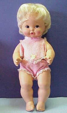 Mattel Baby Tender Love 1969. One piece dublon body. Original clothes. Rooted hair. A drink and wet doll.