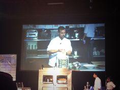 Chef Bryan Voltaggio making pasta on stage.