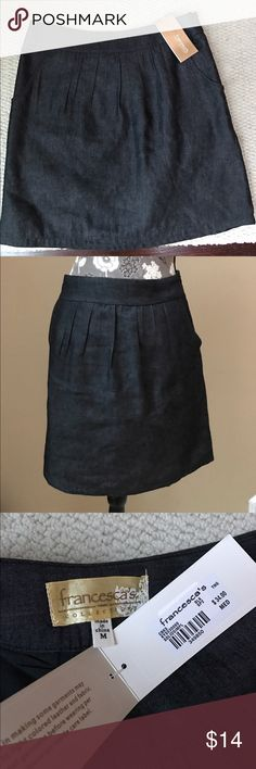 """NWT Francesca's denim colored skirt NWT Francesca's denim colored skirt size medium.  Lined, has a side zipper, 2 front pockets. 14"""" across waistband and 18"""" long. Francesca's Collections Skirts"""