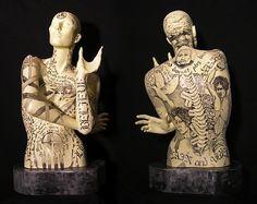 "Reconciliation by Joyce DiBona Pen and Ink on Acrylic/ Fiberglass/epoxy ~ 34"" x 17"""