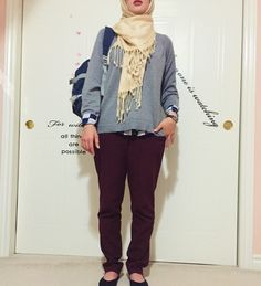 Back to school preppy 2 look. Mix a gold hijab, grey undertone pullover to even out the the hijab, and a navy blue blouse (with white checkers if you want to be creative). Add burgundy pants, oxford black shoes and a black watch, some silver accessories, and you're good to go for your second day of school!