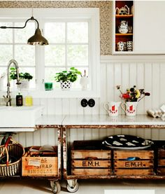 country vintage kitchen - love the rusty old metal frame, big wheels and wooden boxes