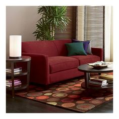 This looks like my current couch, which I love.  It looks so cozy and I like that the pillow colors are kind of unexpected but work.