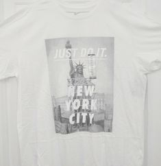 eb7a7e9af23bc4 NWT NIKE NYC NEW YORK CITY STATUE OF LIBERTY WHITE T-SHIRT 914292-100