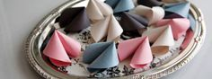 """Paper Fortune Cookie Favors - Here's a batch of """"cookies"""" you'll love to share! You'll be creating them for everything... and writing special messages for bridal showers, weddings, baby showers, and birthday parties. Sneak one into a lunch bag or someone's desk. Another fun idea is to gift someone a pretty jar full of them with a note to open one on every day they need a little cheer (perfect for birthdays, a college student going away to school, or for an out-of-town friend)."""