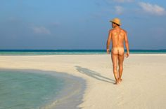 naked men on beach | Nude Man Walking On Beach Rear View Stock Photo | Getty Images