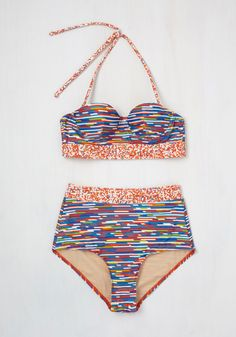 """When life presents it's sunny side, live it up in this stunning swim top! A High Dive by ModCloth style made with amazing Liberty Art fabrics anda single-darted cup for a retro shape, this brightly striped top flaunts a removable halter strap, a bustier-style construction, and a vibrantly dotted band that leave you happily saying, """"This is the life!"""""""