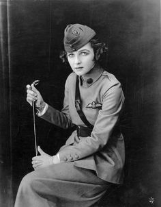 "Irene Castle in uniform, 1917. ""The glamorous dancer Irene Castle wearing a World War I ""Preparedness Uniform"" of her own design. The dress was based on the uniform worn by her husband and partner, Vernon Castle, an aviator in the Royal Flying Corps. During their heyday, the Castles were the epitome of style and sophistication and Mrs. Castle's wardrobe was frequently copied by society women."""