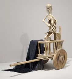 Death Cart (Carreta de la Muerte) c. 1880-1900 Cottonwood, spruce wheels, paint, hair, sheep's teeth (?), glass or obsidian eyes, rope, black wool/silk mantilla Artist/maker unknown, Possibly made near Taos, New Mexico, United States, North and Central America