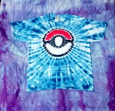 I tie dye on Tuesdays, wash out Wednesdays. Any orders that are received by 9 a.m. on Tuesday will go out by the end of the week. If you have a special timing request, please message me. Gildan Brand, Cotton 100%, Will not shrink anymore, but sizes are approximate due to manufacture differences. (in inches) XS S M L BODY WIDTH 15 16 17 ½ 18 ½ FULL BODY LENGTH 20 ½ 20 ½ 22 ½ 24 SLEEVE LENGTH 5 5 ½ 6 6 ½  Your shirt will have the same colors, but vary slightly to make your shirt unique. And…