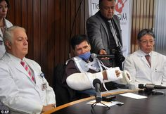 New arms: Gabriel Granados Vergara, 52, center, talks to the press after Latin America's first double arm transplant. He's accompanied by Dr. Martin Iglesias Morales, right, and Dr. Fernando Gabilondo Navarro, left