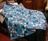 Square Dance by Bev Getschel in Best Fat Quarter Quilts 2014.