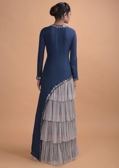 Teal Long Dress In Crepe With Asymmetric Cut And Cloud Grey Layered Details Online - Kalki Fashion Source by dresses indian Hijabi Gowns, Indian Gowns Dresses, Indian Long Dress, Dress Indian Style, Stylish Dress Designs, Stylish Dresses, Elegant Dresses, Indian Designer Outfits, Designer Dresses