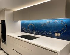 This beautiful piece of art is a fused glass splashback that went to a home in Cambridge. The design features a beautifully abstract shoal of fish all swimming in unison, working away from left to right as they make their way up towards the shallower waters above. The waters are created with soft gradients and skilful powder work, expertly depicting the depths and the shallows. You can even see sunbeams streaming through from overhead. Glass Wall Art, Fused Glass Art, Glass Kitchen, Kitchen Art, Cambridge House, Custom Glass, Bespoke Kitchens, Splashback, Panel Art