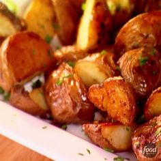 Recipe of the Day: Ina's Garlic Roasted Potatoes It's no wonder Ina's simple, crispy roasted potatoes made it on our list of most-saved recipes. They're perfect with roast chicken for a weekday meal or featured on a buffet table for a weekend get-together. Either way you serve 'em, they won't last long.