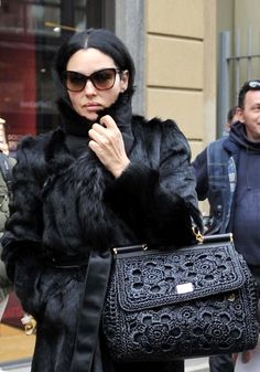 Monica Bellucci in #dolcegabbana and carrying Sicily bag whilst out and about in Milan @