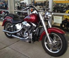 2004 Harley Davidson Fatboy motorcycle with slotted six spoke wheels, a diamond plate theme, handgrips foot A. and foot controls, Screamin Eagle air cleaner, straight exhaust pipes, a mustache engine guard, a detachable passenger backrest and a windscreen: The 2004 HD FAT BOY for Sale has slotted six spoke wheels, a diamond plate theme, handgrips foot A. and foot controls, Screamin Eagle air cleaner, straight