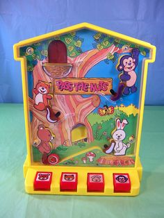 1974 yellow TOMY Pass The Nuts pinball game...i had a winnie the pooh one like this!