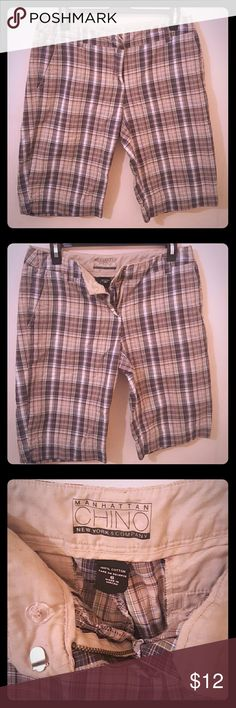Manhattan New York & Co beige plaid chino shorts These are beige plaid chino bermuda shorts with a hint of blue to appeal to the eye ??. Front flat short with side pockets and flat inserted back pockets. Great shorts that have been gently loved. Free of rips, stains, & damage. New York & Company Shorts Bermudas