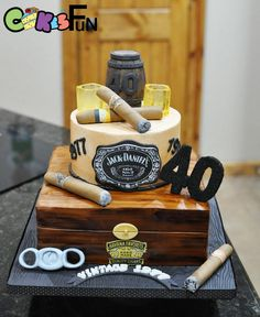 Manly cake for a 40th Birthday. Keg is made with RKT and fondant. Shot glasses are molded sugar glass. Cigars are made with marshmallow fondant.