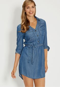 <ul><b>Overview</b><li>super soft chambray fabric</li><li>v-neckline with three buttons</li><li>floral lace interior yoke</li><li>adjustable tie waist</li><li>two front pockets</li><li>long easy to roll sleeves with button tabs</li><li>pair with leggings and boots</li></ul><ul><b>Fit and Sizing</b><li>measures 36 inches from top of shoulder to bottom hem</li><li>measured from a size medium</li></ul><ul><b>Fabric and Care</b><li>Style Number: 75856</li><li>Imported</li><li>100%…