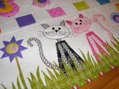 Cute little kitties!!!  This was a side border on a bed quilt but would make a great table runner or skinny quilt.