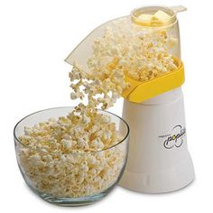 Hot Air Popcorn Popper. With melted raw virgin coconut oil and a pinch of pink himalayn sea salt. Yumm.