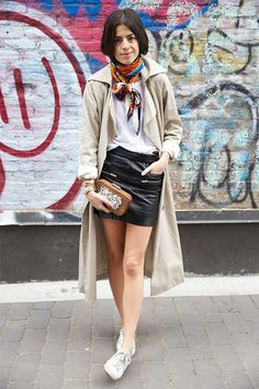 With white t-shirt, leather skirt, white sneakers, beige trench coat and clutch - Styleoholic Elle Fashion, Next Fashion, Star Fashion, Girl Fashion, Punk Fashion, Petite Fashion, Lolita Fashion, Curvy Fashion, Fashion Boots