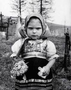 A child in a cemetery holding flowers, Prague, Czechoslovakia, photograph by Frank Scherschel. Half The Sky, Vintage Children Photos, Folk Costume, Costumes, Photo Black, My Heritage, Vintage Photographs, People Around The World, Traditional Dresses