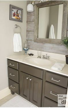 Bathroom inspiration - Painted gray vanity with updated hardware for a rustic look.