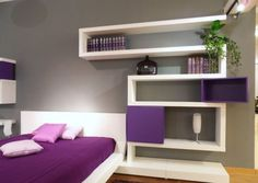 Modern Purple Bedroom Design With Wall Shelves In