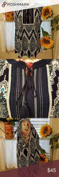NWT beautiful sleeveless top/blouse XXL Just arrived!! Beautiful rxb top. Beautiful colors of blues,very dark blues, and black, turquoise, and white/off white. Super detailed and wonderful embroidery/tapestry. Loose and flowy with cute tie at neck with tassels. Very cute dressed up or down with jeans or leggings. Gorgeous unique top perfect for spring and summer wardrobe. rxb Tops