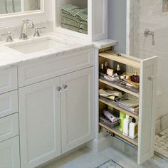 After designing a custom double vanity for their master bath, this couple was left with almost 6 inches of space on each side. So they built spice-rack-style storage that now keep toiletries close at hand but out of sight.